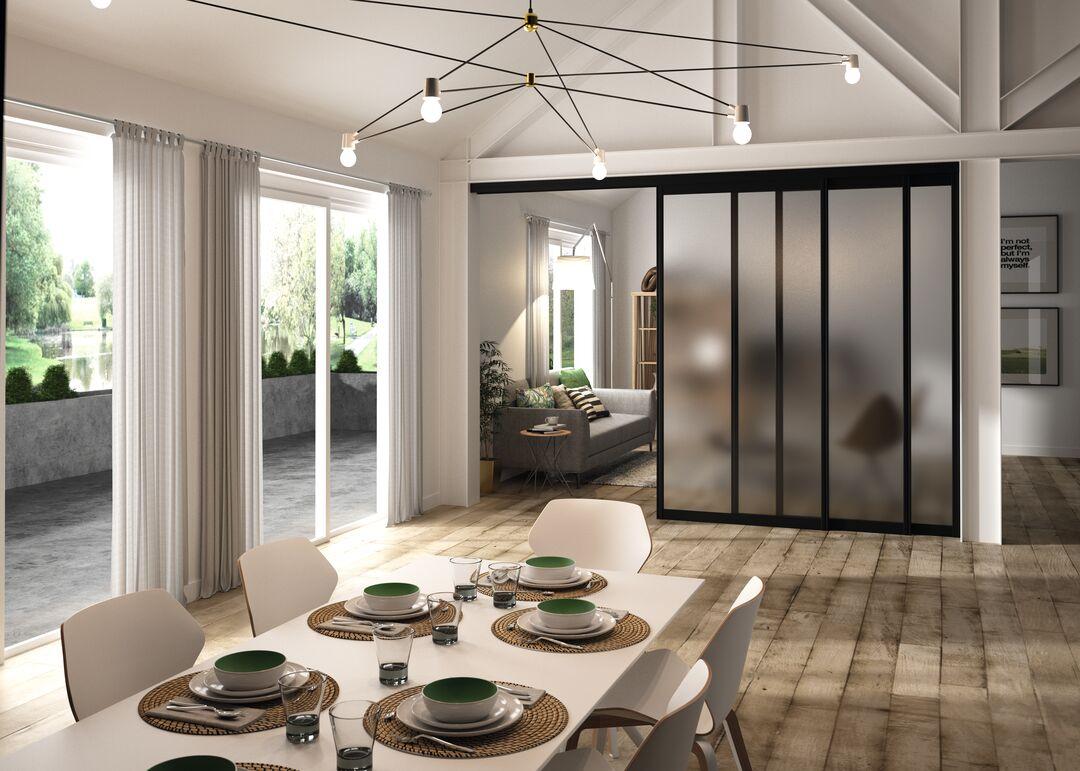 Une salle à manger séparée du salon grâce à une porte coulissante